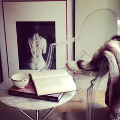 Ghost chair draped in fur by Angela Leland Interiors