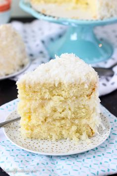 This Coconut Custard Cake is layers of coconut cake, with a coconut custard filling and finished with a cream cheese icing.
