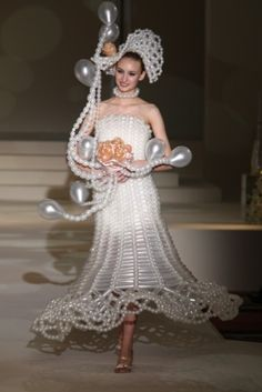 hahaha! wedding dress made entirely of balloons!. You give the groom a straight pin once you arrive at the honeymoon suite!