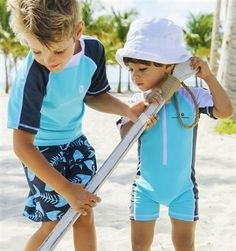 Love this matching big brother, little brother beachwear available at now at www.snowballsandsandcaatles.co.uk