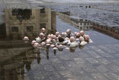 Isaac Cordal sculpture depicting politicians discussing global warming