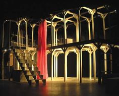 Romeo-and-Juliet by Peter Watson Scenic, via Flickr  Note the interplay of light and vertical structures. The play of light on the mauve fabric piece is especially impacting. The open spaces allow for a variety of playing areas.