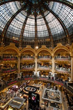 Galeries Lafayette, is a fashion mall located at boulevard Haussmann, in the arrondissement of Paris. Only in Paris would a mall be this spectacular! Open since 1912 it is an icon in the city of fashion A must see Paris Travel, France Travel, Paris France, Paris Paris, France Cafe, Montmartre Paris, Paris Cafe, Galerie Lafayette Paris, Galeries Lafayette