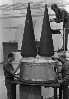 Technicians work on the warheads of an Minuteman III intercontinental ballistic missile - U.