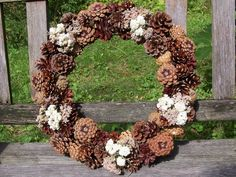 Pine Cone Wreath with Dried Flowers, Everlasting Pearl and Pink Yarrow.   www.etsy.com/shop/NaturesCraftSupply