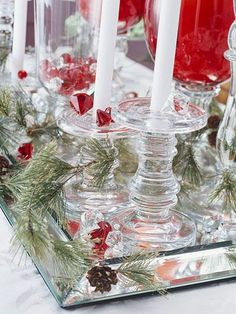Flashy Mirror Centerpiece     Place a long mirror along the center of the table. Top the mirror with evergreen sprigs, pinecones, candles, and small red plastic jewels for an eye-catching centerpiece. Just don't crowd the mirror -- it will reflect whatever you put on it, making it look twice as full