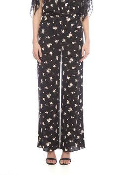 Printed crepe flare pant. Pair with Anna Sui's notching print top to be right on trend.   Printed Flare Pant by Anna Sui. Clothing - Bottoms - Pants & Leggings - Flare & Wide Leg Clothing - Bottoms - Pants & Leggings - High-Waisted SoHo, Manhattan, New York City Manhattan, New York City