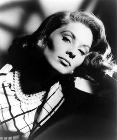 """Suzy striking a Garbo-esque pose in 1957.  This """"glam"""" shot harks back to 1930's movie portraits.  Can ya DIG those cheekbones...!!!???"""