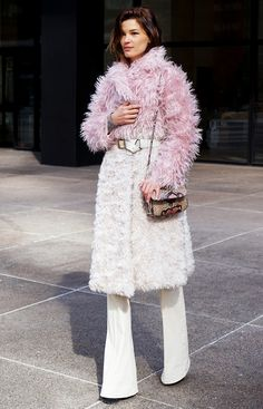 Hanneli Mustaparta of Hanneli in a glam and feminine pink ombre fur coat and white flares // NYFW Street Style