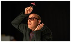 Willie Garson prepares for rain during the Nigel Parry photo shoot.