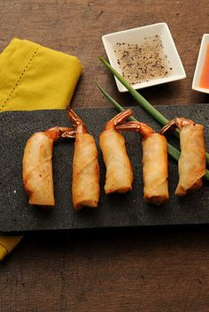 Lumpia - Filipino–style spring rolls -  The filling varies, but one thing remains the same: You can (and will) inhale them by the dozen.