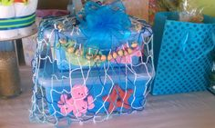One of my many Baby shower gifts i received from a good friend..my theme was an under the sea/ocean theme for my baby boy!! The Kukui nuts also contained baby's name.