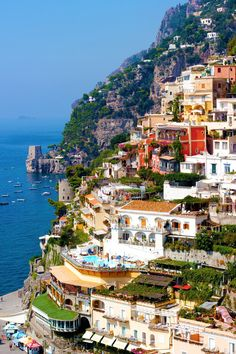 Positano (Italy). 'Pearl of the Amalfi Coast, Positano is scandalously stunning, a picture-perfect composition of pastel-coloured houses tumbling down towards a deep indigo sea. This ease with beauty also informs its skinny, pedestrian streets, lined with chic boutiques for fussy fashionistas. Just don't forget neighbouring Praiano