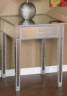 The stylish Mirage Mirrored Accent Table will enliven any room in your home while shining reflective light.