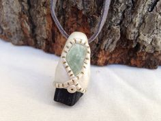 Black tourmaline and aquamarine stone polymer clay necklace on suede on Etsy, $30.00