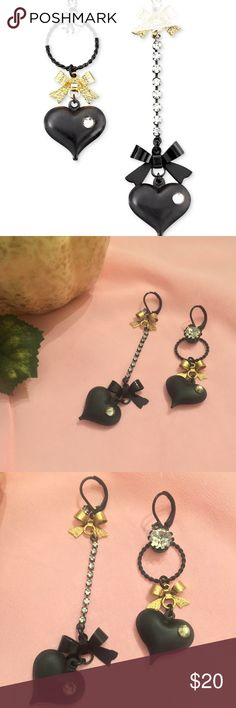 NWOT - Betsey Johnson asymmetrical earrings NWOT - Betsey Johnson cute asymmetrical black  earrings. Earrings have cute black heart with a gold bow on the top. Betsey Johnson Jewelry Earrings