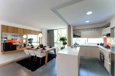 Home Design, Rectangular Mirror Wall Black Fur Rug Dual Fuel Ranges With Stainless Steel Ovensingle Hole Faucet Glass Backsplash Undermound Sink And Kitchen Island Countertop Porcelain ~ Swank Modern House Design with Zesty Orange Decoration Touches Contemporary Interior Design, Modern House Design, Home Interior Design, Rug Under Dining Table, Dining Table Chairs, Dining Area, Kitchen Flooring, Kitchen Dining, Open Kitchen