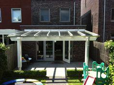 Het zelf bouwen van een glazen terrasoverkapping - VD Griend