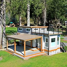 This 400 sq ft tiny house with wide open floor plan was built by the 'West Coast Homes'. It's named the 'Bellevue' located on the 'Wildwood Lakefront Small Tiny House, Tiny House Cabin, Tiny House Living, Tiny House Design, Tiny House On Wheels, Small House Plans, Tiny Beach House, Tiny House Office, Tiny House Trailer Plans