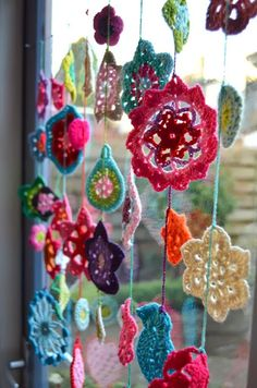 crochet flowers in the window. My mother in law offered me a bunch of white ones...