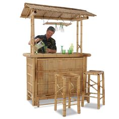 The Genuine Bamboo Tiki Bar - Hammacher Schlemmer- expensive! Tikki Bar, Outside Bars, Bamboo House, Bamboo Crafts, Tiki Party, Bamboo Furniture, Tiki Hut, Patio Bar, Bar Set