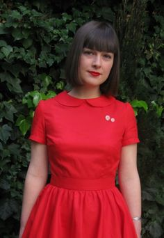 Red dress with peter pan collar.