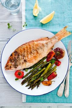 Grilled red snapper with roasted mixed peppers and asparagus