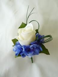 White bud rose with a touch of dark blue hydrangea. I love this http://www.purenzweddings.com/about-us