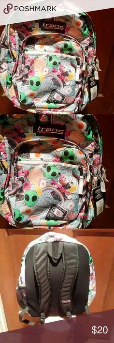 """trans by Jansport girls backpack This is a Jansport 17"""" Supermax backpack- School Daze.  It features two zipper closures that open up to roomy interior.  There are two outer pockets on the outside along with a side mesh pocket for placing a water bottle.  It has aliens, rainbows, cupcakes and shells on it. trans by Jansport Other"""