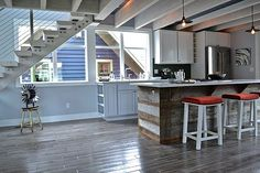 Work in Reclaimed WoodLove the island--bar stools look practical and comfy to sit on at counter height