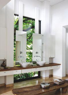 Contemporary bathroom...love the natural sunlight. #bathroom tiles, shower, vanity, mirror, faucets, sanitaryware, #interiordesign, mosaics,  modern, jacuzzi, bathtub, tempered glass, washbasins, shower panels #decorating