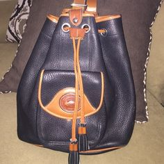 Dooney & Bourke Tassel Back Pack Purse Navy and Brown classic colors.  In excellent condition.  Please feel free to ask any questions Dooney & Bourke Bags Backpacks