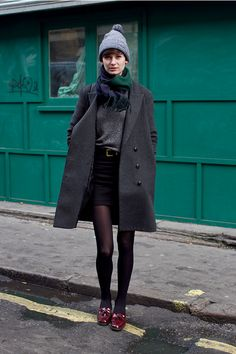 long dark gray wool coat | black trouser shorts | heathered gray sweater | tights | tassel loafs