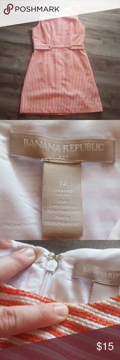 Banana Republic factory orange and white dress Banana Republic factory orange and white stress with gold button detail. Slight discoloration by neck on outside and inside. Size 12. Dress is approximately 35 inches long, 18 inches pit to pit and 16 inches at waist. Banana Republic Dresses