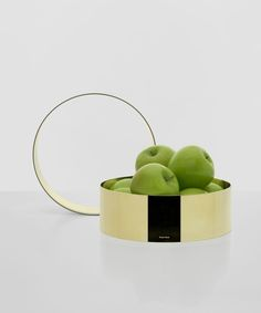 A seamless band of solid spun brass. Placed on a table Brass Band will 'fence in' fruit and vegetables. When not in use it hangs from it's own cork hook.