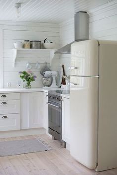 Serene white summer cottage kitchen with a vintage style refrigerator. Serene white summer cottage kitchen with a vintage style refrigerator. Vintage Kitchen Decor, Home Decor Kitchen, New Kitchen, Home Kitchens, Kitchen Dining, Kitchen Ideas, Kitchen White, Kitchen Inspiration, Awesome Kitchen