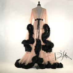 Also available in other colors. Dramatic sheer cafe au lait dressing gown, trimmed with oodles of lush black marabou. Gown is made from a...
