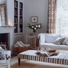 Neutral living room with sofa, floral curtains and striped stool | housetohome.co.uk