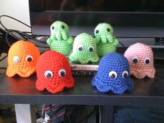 Crocheted Pac Man Ghosts and Cthulhus I made for Halloween favors this year.    The cthulhus are from the book Creepy Cute Crochet.    Ghost pattern: http://agamerswife.blogspot.com/2011/10/pac-man-ghosts-pattern.html