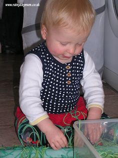 Colored spaghetti sensory play for babies