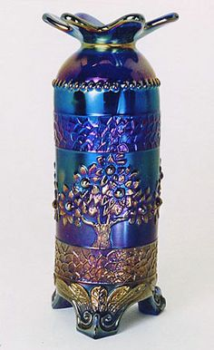 Whimsy: Fenton Orange Tree blue carnival hatpin holder with an altered top. Via http://www.ddoty.com/.