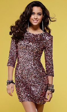 This sexy short sequin dress by Scala sparkles like pink champagne for your next semi formal affair. A dazzling short cocktail dress with slim fit design that's sure to flatter your figure and look great at prom, homecoming or special occasion party. With three quarter length sleeves, boat neckline with scoop neck in back, this sexy mini dress is sure to impress at prom or party.