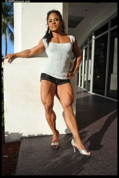 Female Bodybuilder Kashma Maharaj posing her impressive legs and muscles for HDPhysiques!