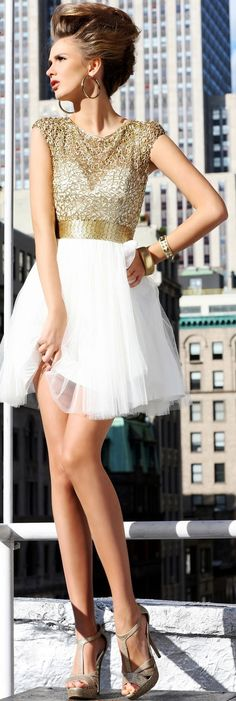 Love this dress! Gold and white are so pretty together