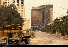 Kuwait War Torn: Burnt Out Army Trucks In The Street Before The Stock Photo, Picture And Royalty Free Image. Pic. 7455147