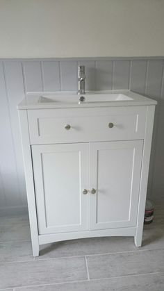 White victoria plumb unit with grey panelling. Paint from Johnstones.