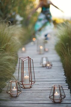 love these... would also look nice with gathered 'fairy lights' inside.  Metalwork Hurricane #anthropologie