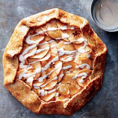 "Apple Galette with Vanilla Yogurt Drizzle | Rustic is gorgeous—that's never been more true than with this fall apple tart. We save on saturated fat and make the whole-grain crust even tenderer by swapping in low-fat yogurt for some of the butter. Make the crust a day ahead and refrigerate, or a couple weeks ahead and freeze (just remember to thaw completely before rolling). Cutting the apple crosswise for a ""star"" shape in the center of each slice adds a special touch, but any slice will…"