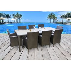 Update your patio, backyard, or kitchen with this Beliani Chiasso 7 Piece Dining Set. It is designed with both durability and comfort in mind. This Chiasso 7 Piece Dining Set by Beliani features a glass table top made with an aluminum frame with six armchairs woven with wicker. It is brown in color, which is visually appealing. This dining set is right at home on your porch, deck, and patio. The seat cushions provides hours of comfortable sitting. This dining set is specially treated for UV…