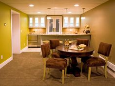 A round table provides room for gaming or extra space for entertaining in this transitional basement.